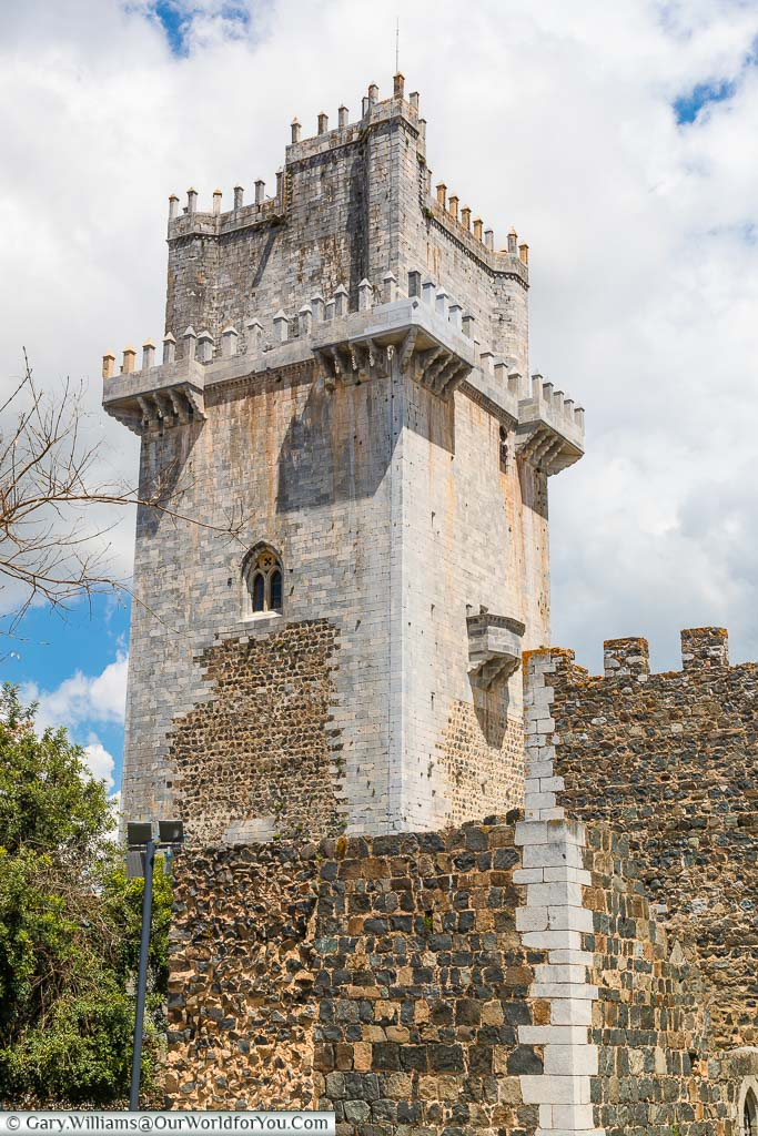 The reconstructed 13th-century tower of Beja Castle in pale grey stonework