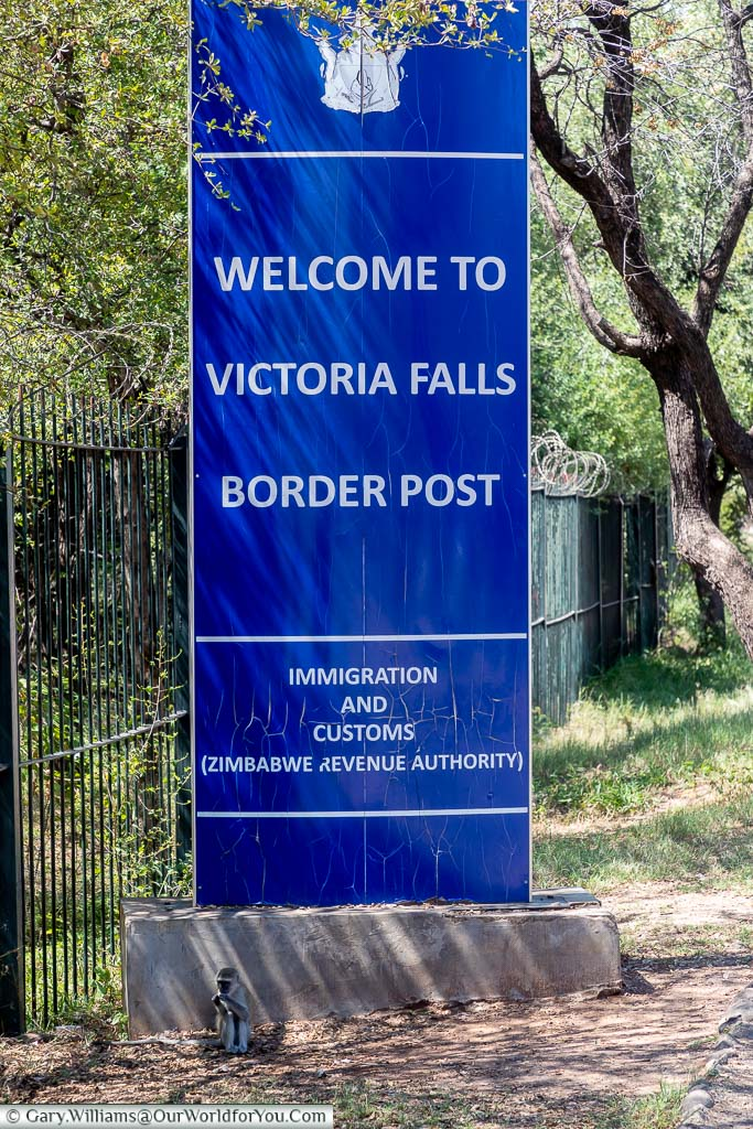 A blue sign at the Victoria Falls Border post on the Zimbabwe side.