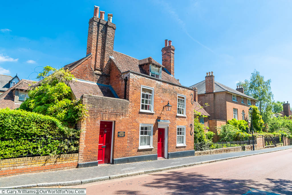 The red-brick Georgian Abbey Brewery House, with its bold red entrance & side door on Swan Street, West Malling, Kent