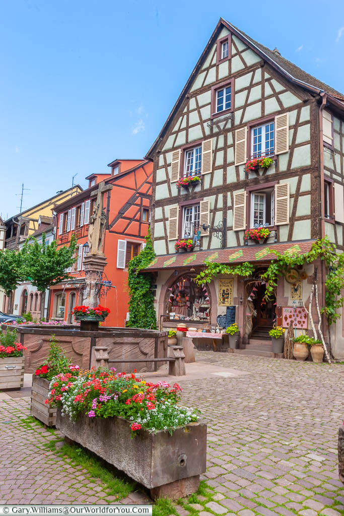 A gift shop in a traditional brightly coloured Alsace half-timbered building in the centre of Kaysersberg, France