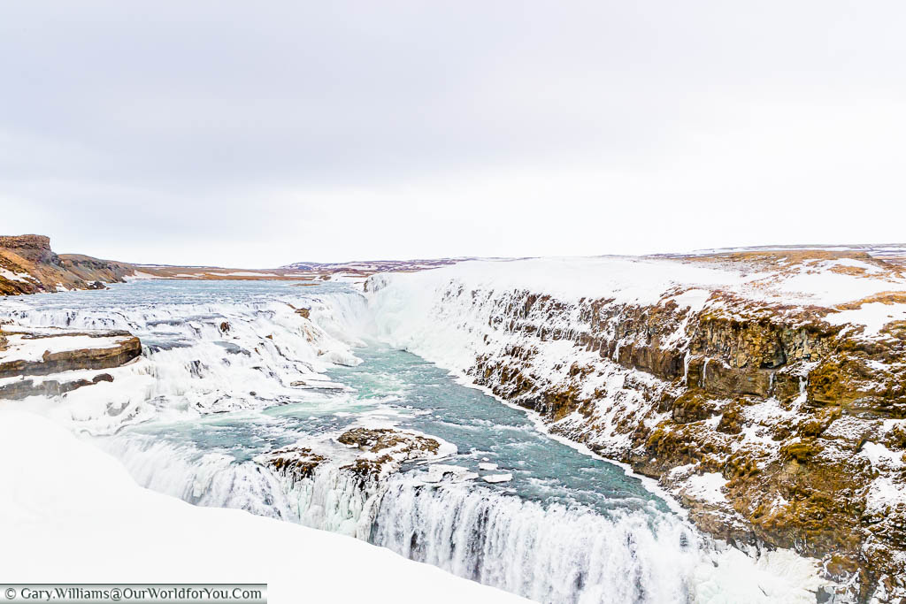 The stunning Gullfoss waterfall captured in mid-March with ice still remaining around the edges. A must-see on Iceland's Golden Circle.