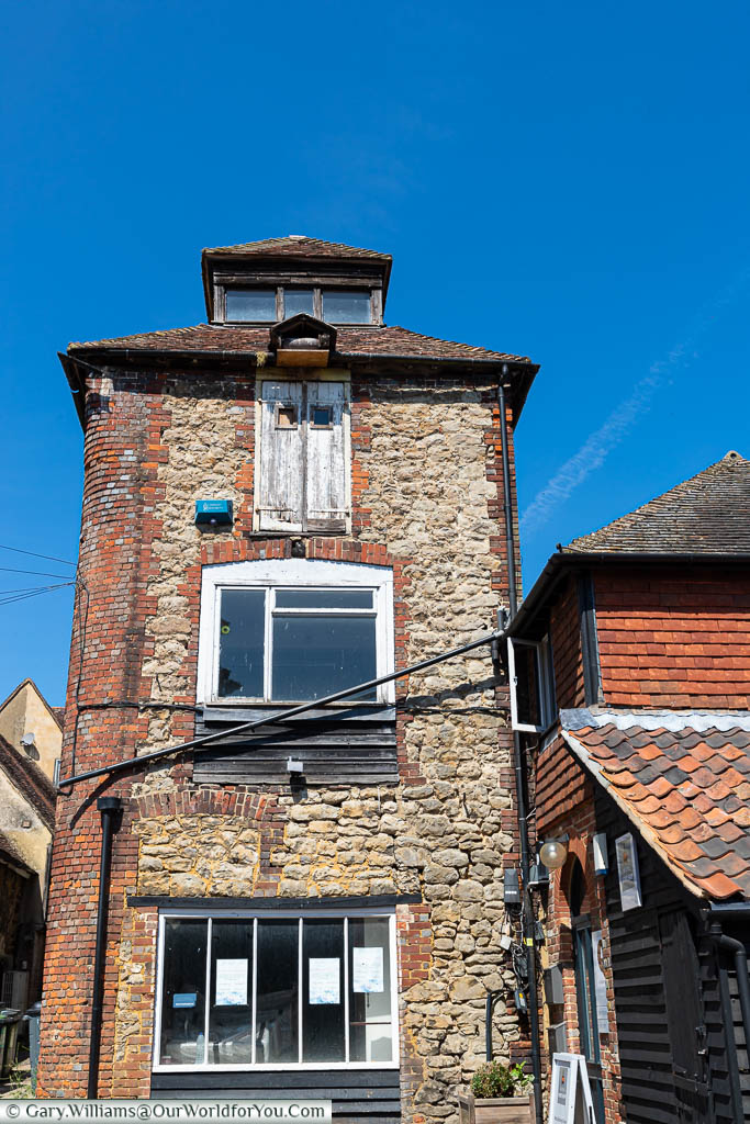 An old red brick and Kent ragstone tower is hidden in Mill yard in West Malling, Kent