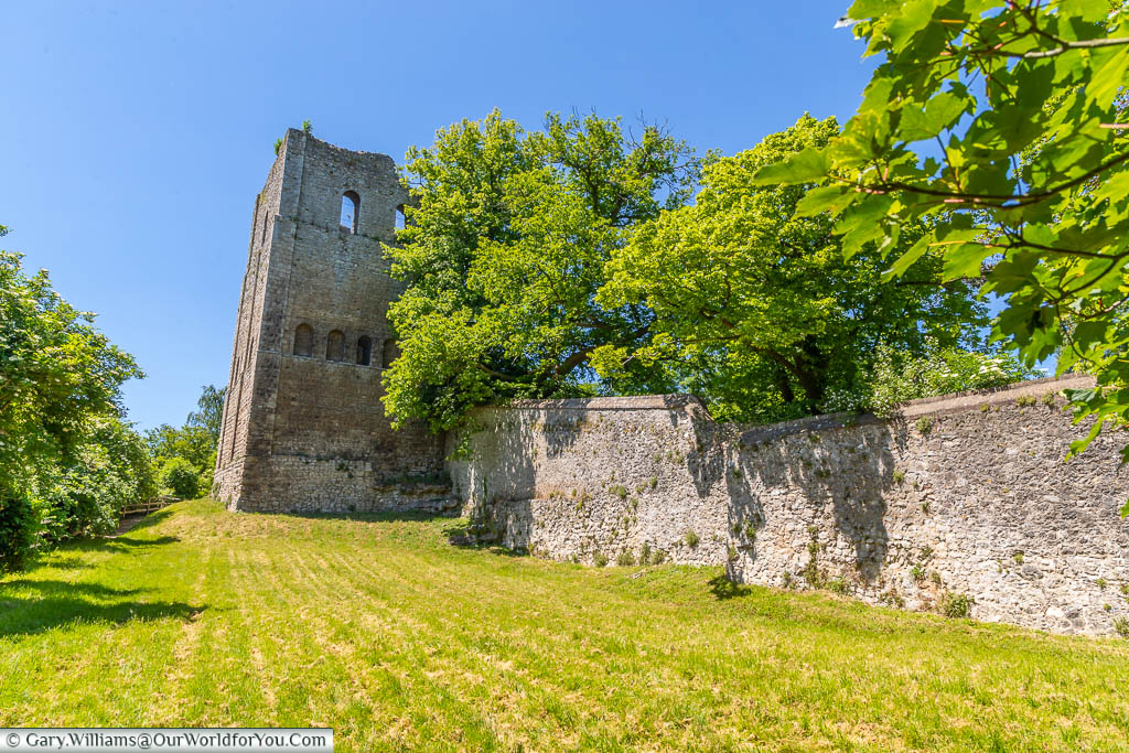Looking up the grassy bank to the wall and remains of St Leonards Tower on the outskirts of West Malling