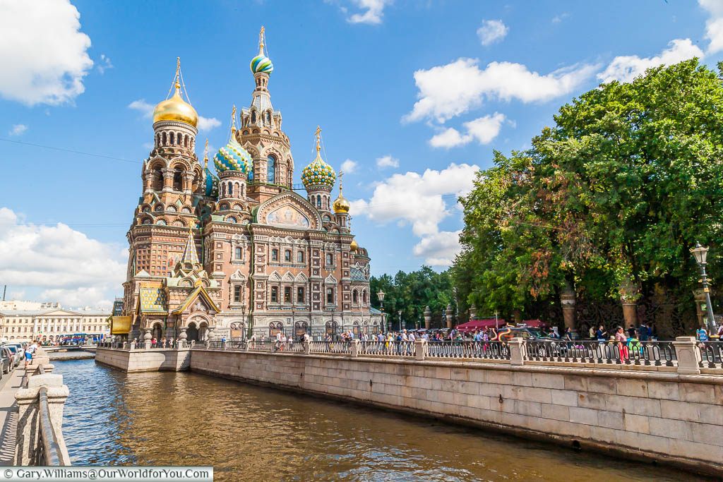 A view of the iconic Church of the Savior on Spilled Blood, on the banks of the Griboedov Canal in Saint Petersburg, Russia. The ornate five domes of different colours & styles dominate the skyline.