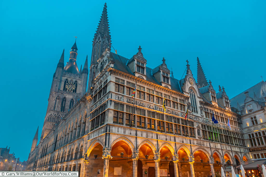 The illuminated gothic Cloth Hall in Ypres under the blue skies of dusk