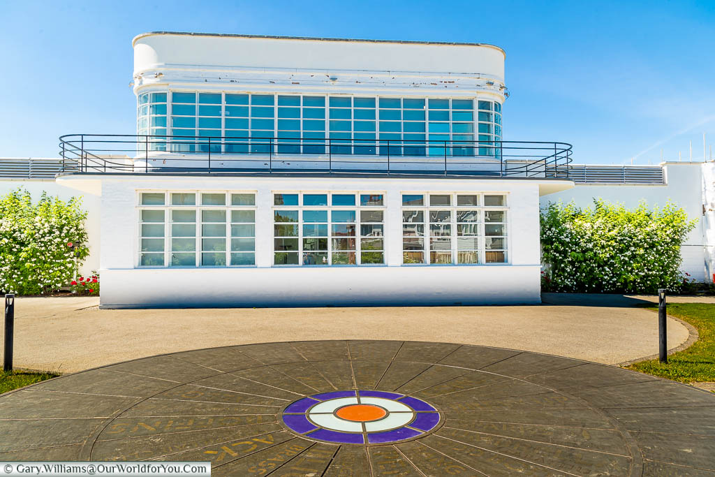 The Royal Ensign installation in front of the white Art Deco Control Tower from RAF West Malling