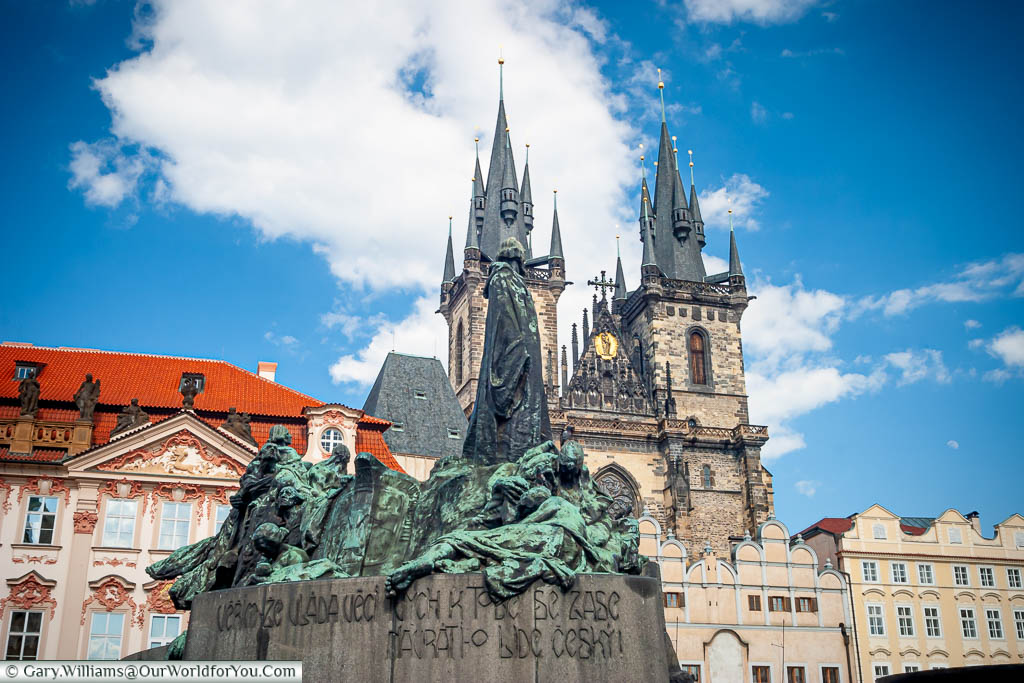 The Jan Hus Memorial in front of the Church of Our Lady before Týn in the old town square in Prague, Czech Republic