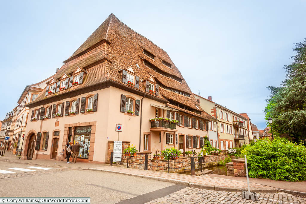 A historic building in the centre of Wissembourg France, with a steeply raked roof that is known as the 'Maison du Sel' or Salt House
