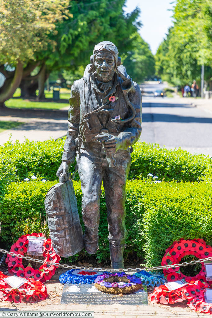 A bronze statue memorial, titled 'running Airman', in the centre of King's Hill, formerly RAF West Malling