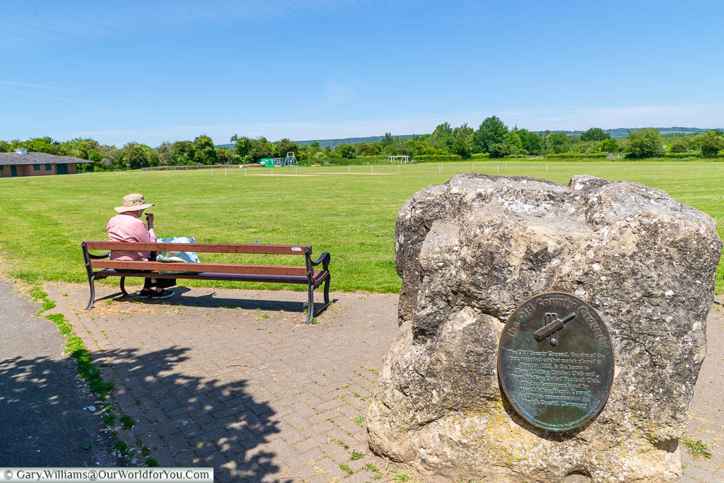 Overlooking the West Malling cricket ground with a stone & plaque commenting its place in history