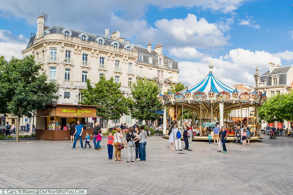 Families gathered in the Place Alexandre Israël in front of the carousel in Troyes, France