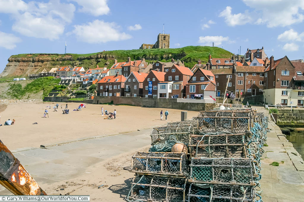 Lobster pots stacked on quayside of Whitby back on the Yorkshire coastline