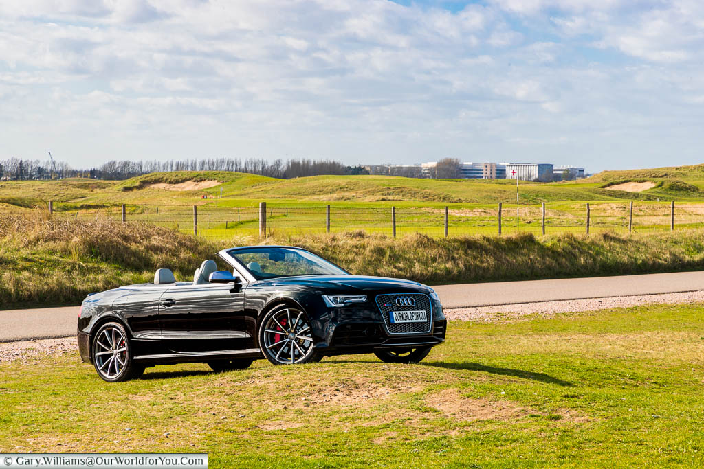 Our black Audi Convertible, with the roof down, parked on the edge of the Royal St George's Golf Club, Sandwich, Kent