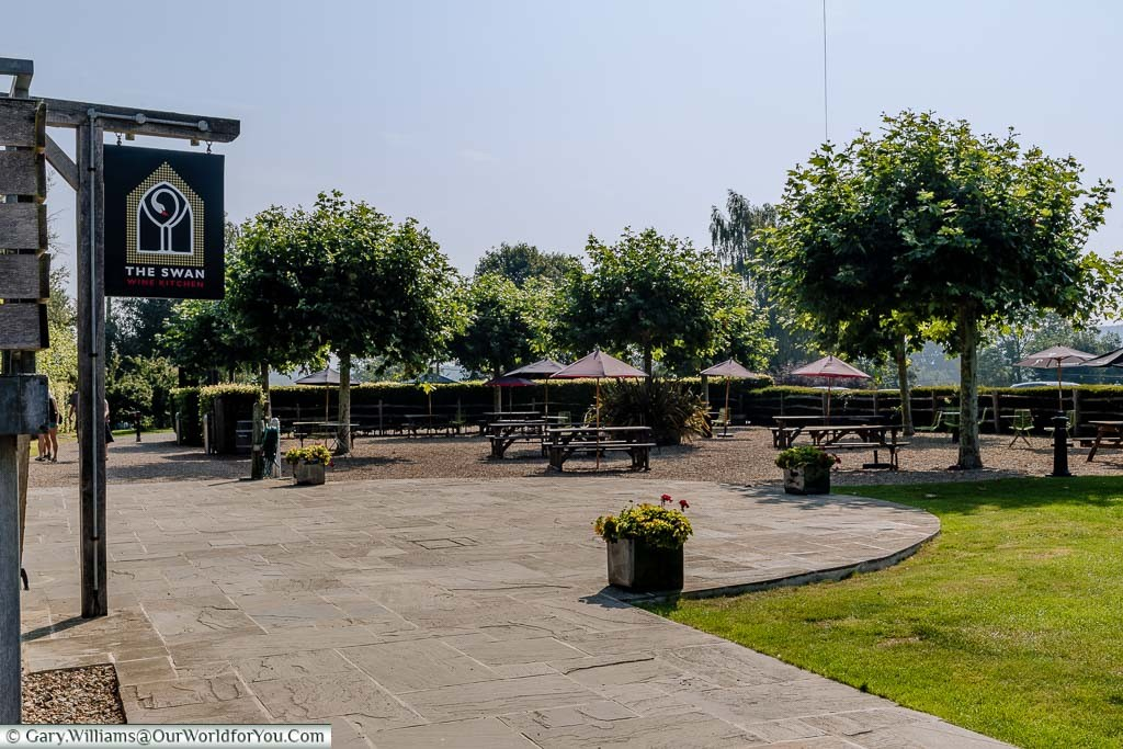 A large picnic area with tables & benches covered with branded parasols for you to enjoy a glass or two of your favourite Chapel Down or Curious Brew.