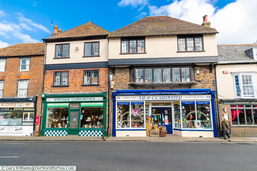 Traditional shops set in historic 16th-century buildings on New Street in the centre of Sandwich, Kent