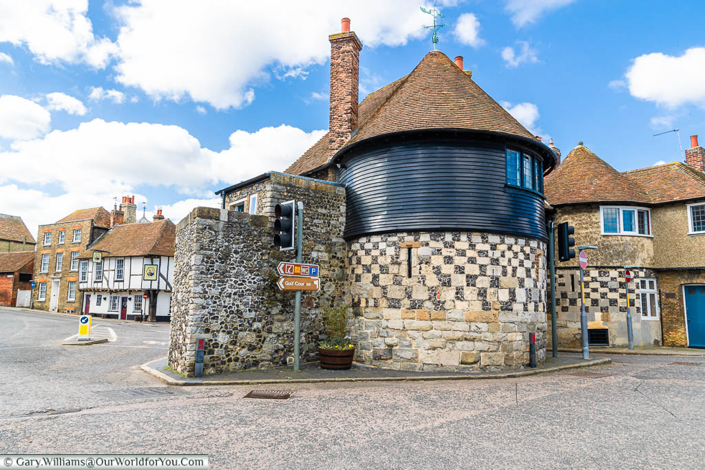 The round towers of the 14th-century Barbican gatehouse on the edge of the old town of Sandwich, Kent