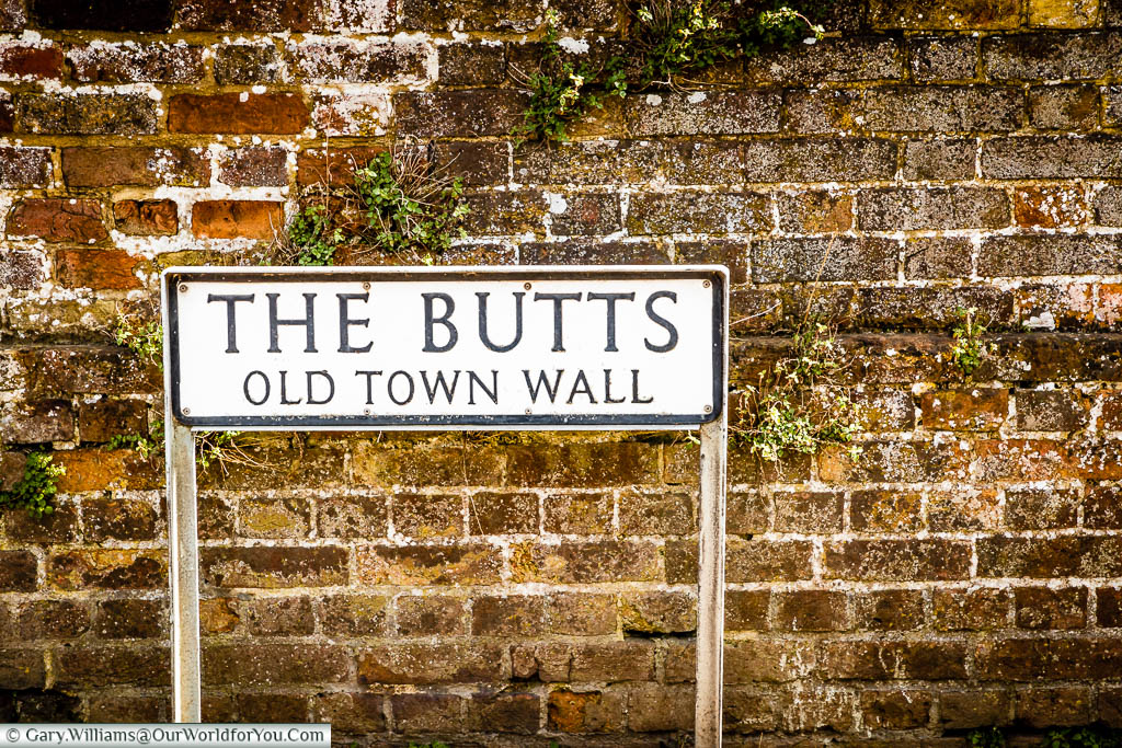 The street sign for The Butts, a pathway that follows the Old Town Wall of Sandwich, Kent
