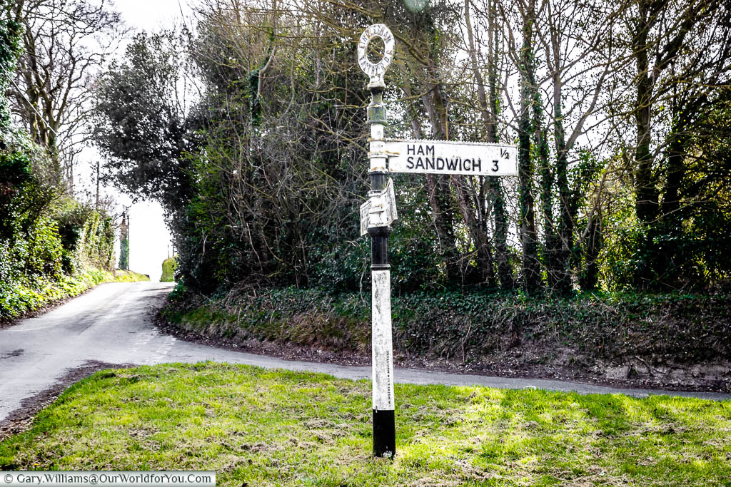 The cast-iron street sign with directions to the hamlet of Ham, and the town of Sandwich, creating a Ham Sandwich sign, just outside Sandwich, Kent