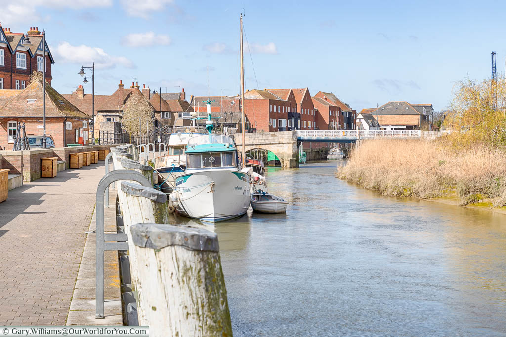 Small boats moored up on the quayside of the River Stour in Sandwich, Kent