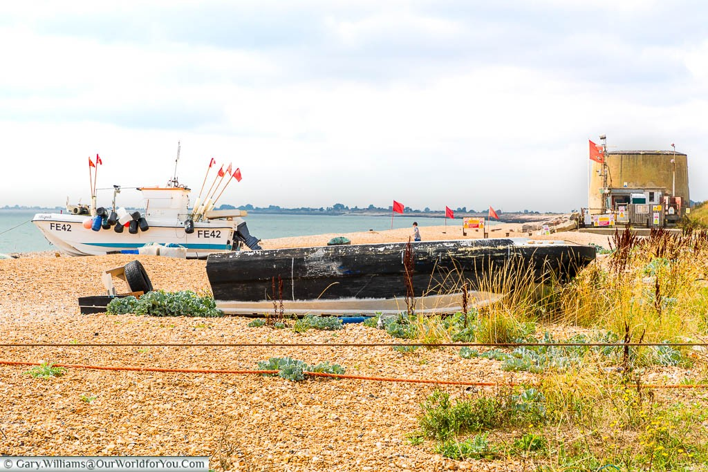 Fishing boats on the beach at Hythe with the Martello Towers in the background