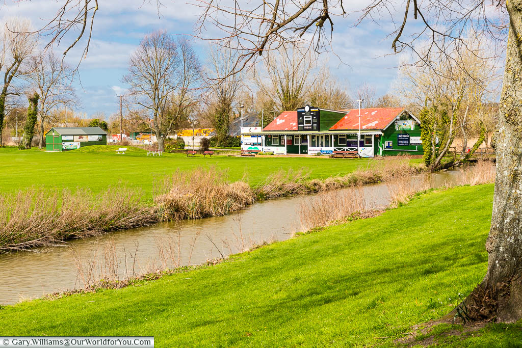 The cricket pitch and pavilion of Sandwich Town Cricket Club alongside The Butts, or the Old town wall of Sandwich