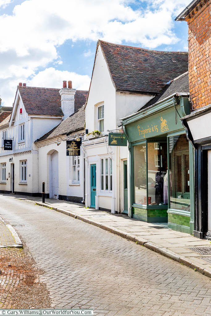 A look up the narrow street known as 'The Butchery', with a mix of listed buildings of different periods
