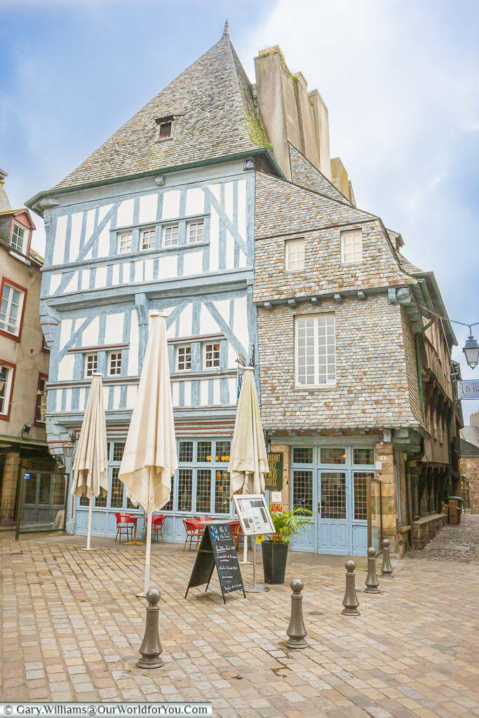 A half-timbered restaurant set back from the cobbles lanes of Dinan, France