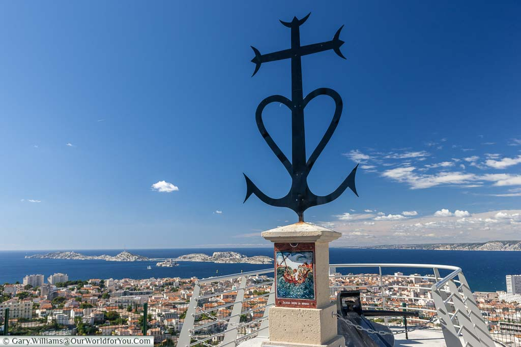 A mariners cross at the viewpoint of the Basilique Notre-Dame de la Garde overlooking the city of Marseille.