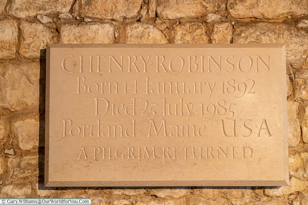 A stone plaque to in the crypt to Charles Henry Robinson, the last private owner of Ightham Mote