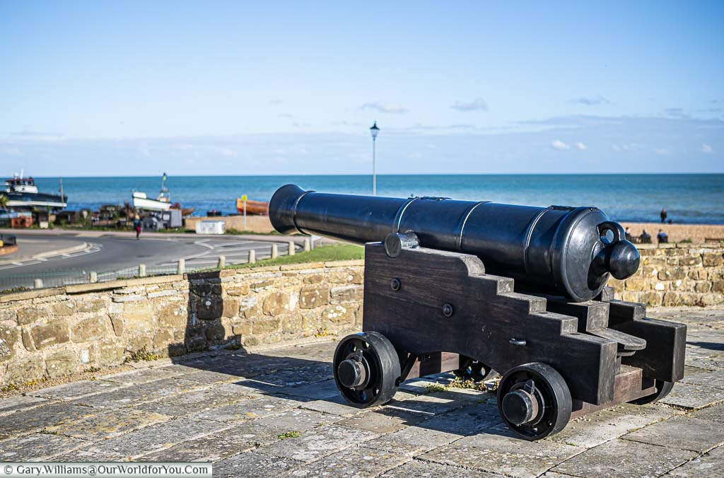A side profile of an 18th/19th-century cast-iron cannon on a wooden carriage on the walls of Deal Castle