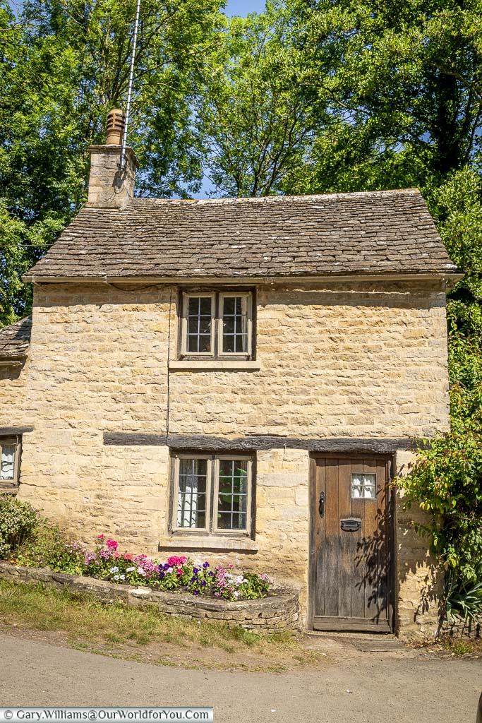 A petite pretty little Cotswold cottage at the top of Arlington Row, Bibury