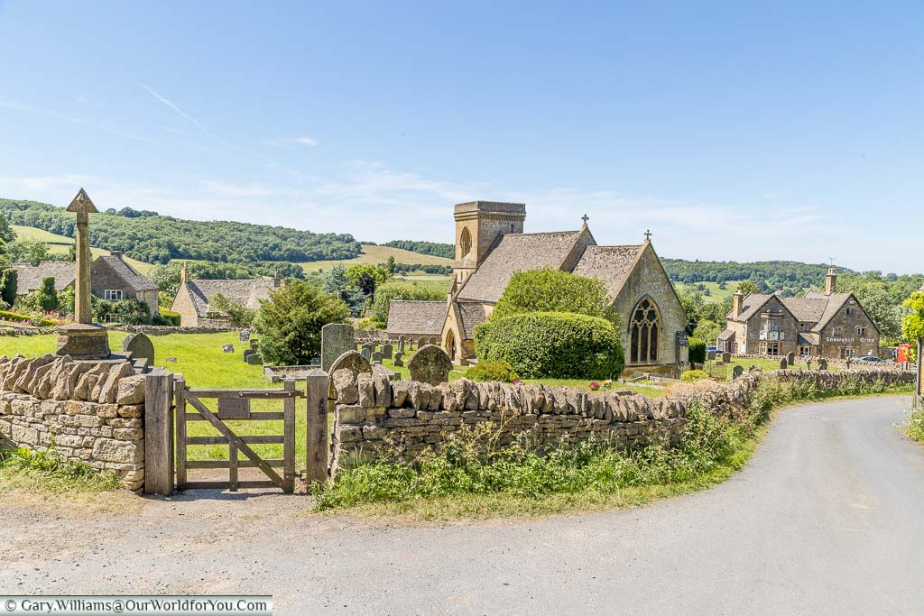 The view of the church & graveyard at Snowshill in the Cotswolds on a bright sunny day