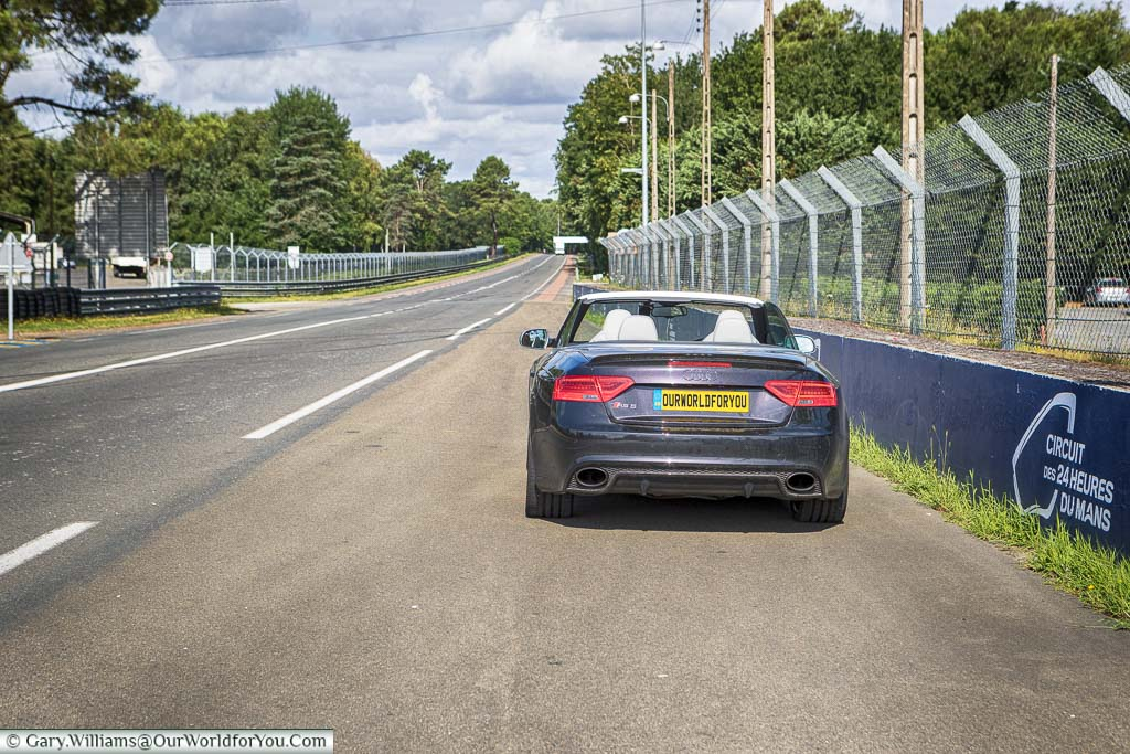 Our Audi convertible at the roadside of the famous Le Mans 24 hours circuit.