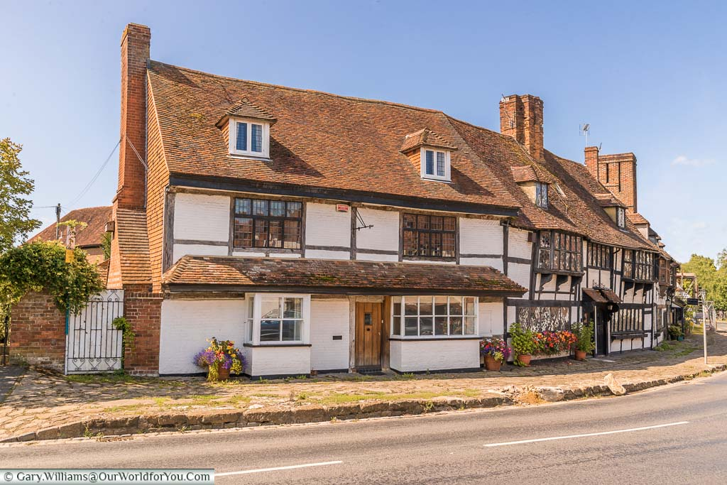 Half-timbered buildings on the corner of the High Street of Biddenden, Kent on a beautiful summers day