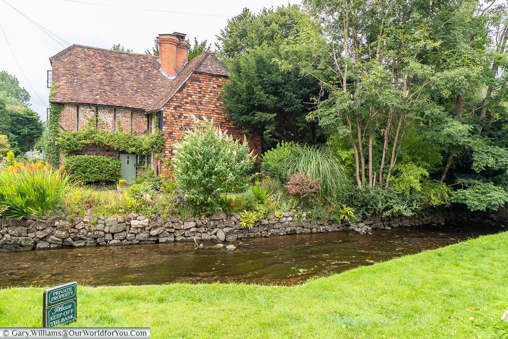 The 16th-century red-brick Bridge Cottage on the banks of the River Darent in Otford, Kent