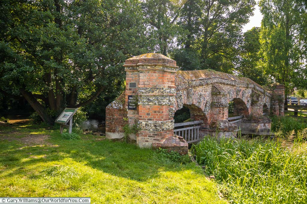 A side profile of the brick-built, three arch Cattle Screen folly over the River Darent in Farningham, Kent