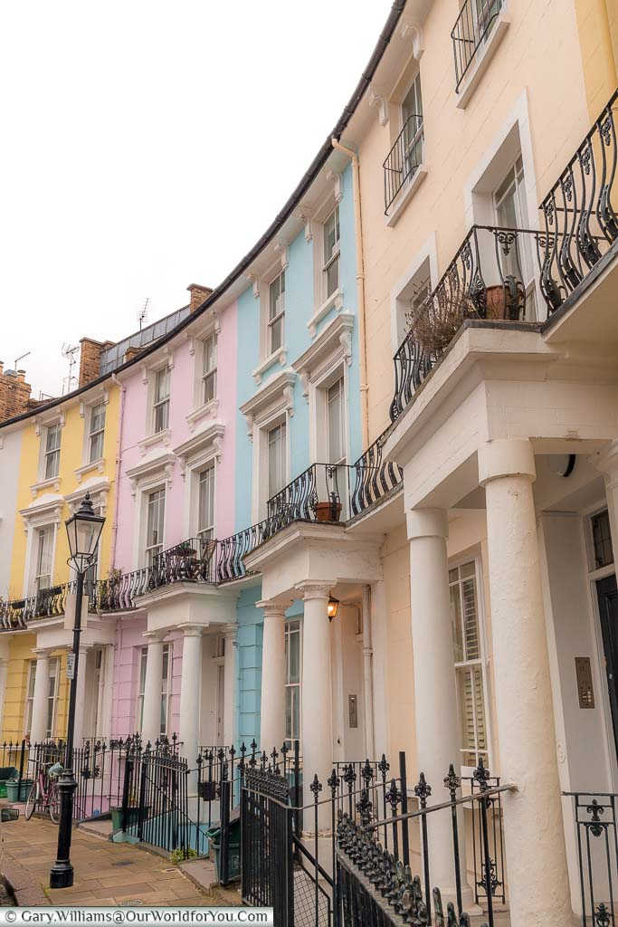 A row of pastel-coloured Georgian homes in along Chalcot Crescent, Primrose Hill
