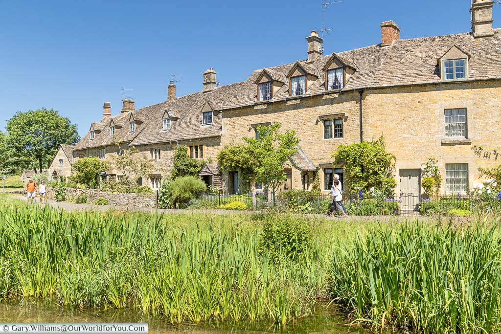 Stone cottages on the banks of the River Eye in Lower Slaughter
