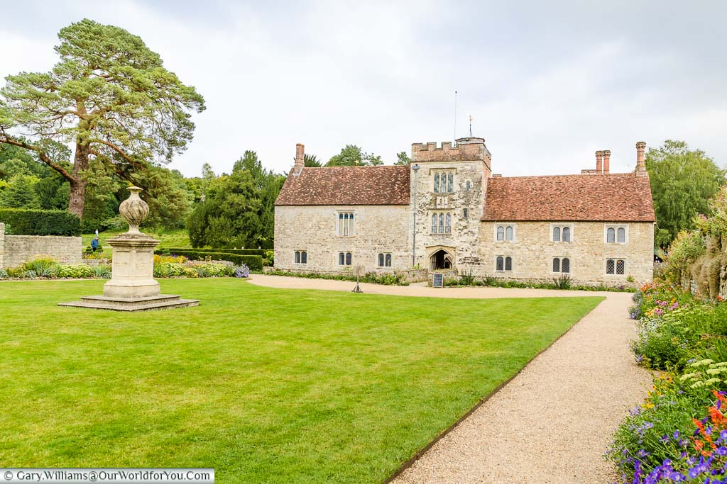 The view of the Stable Courtyard overlooking the the old manor house of Ightham Mote