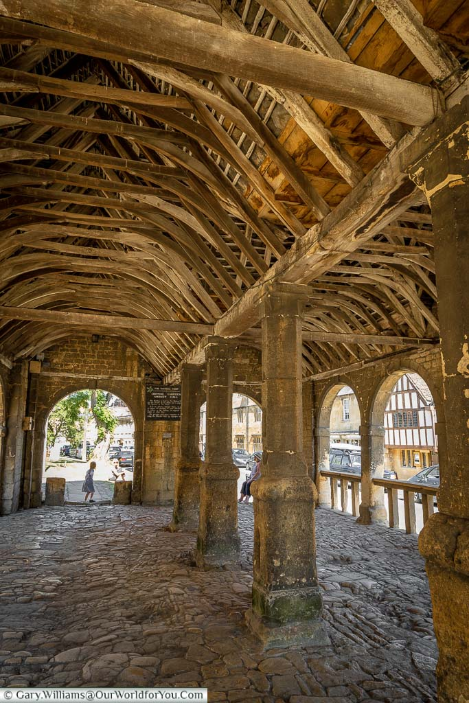 Inside the 17th-century stone Chipping Campden Market Hall with its timber-framed roof