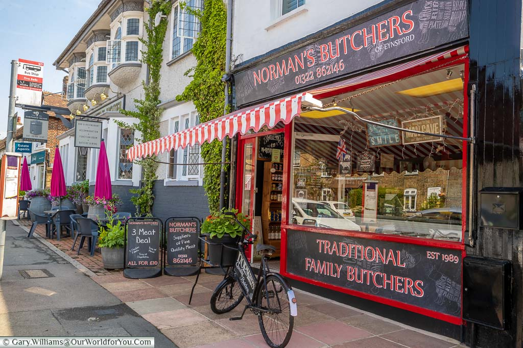 Norman's Butchers, a traditional family butchers, complete with butcher's bike outside on Eynsford High Street