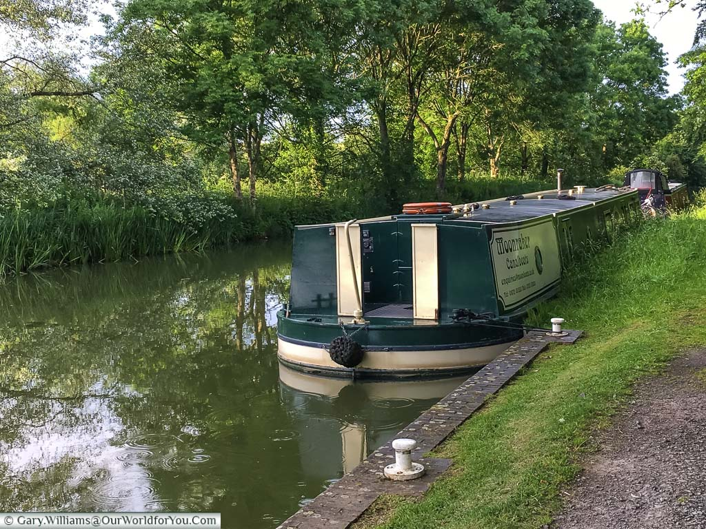 The aft end, or back to you & I, of our Moonraker canal boat safely moored up at the end of a day barging on the waterways of England