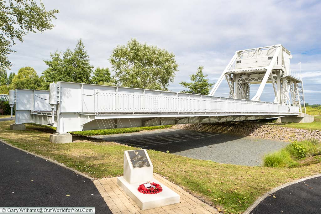 A stone monument in front of the now relocated Pegasus Bridge in Normandy.