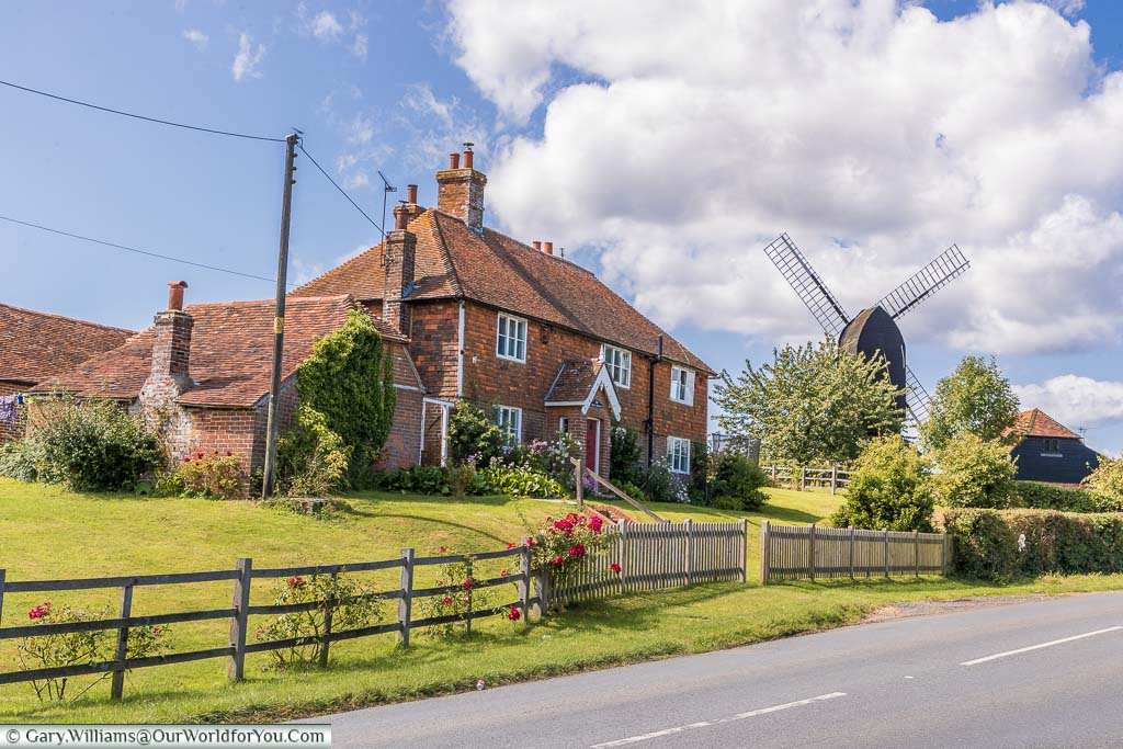 The Rolvenden Windmill and a country house just by the roadside as you leave the village.
