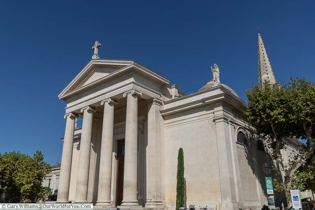 The beautiful St Martin church In a cream sandstone with 4 columns in front of its enormous entrance against a deep blue sky.