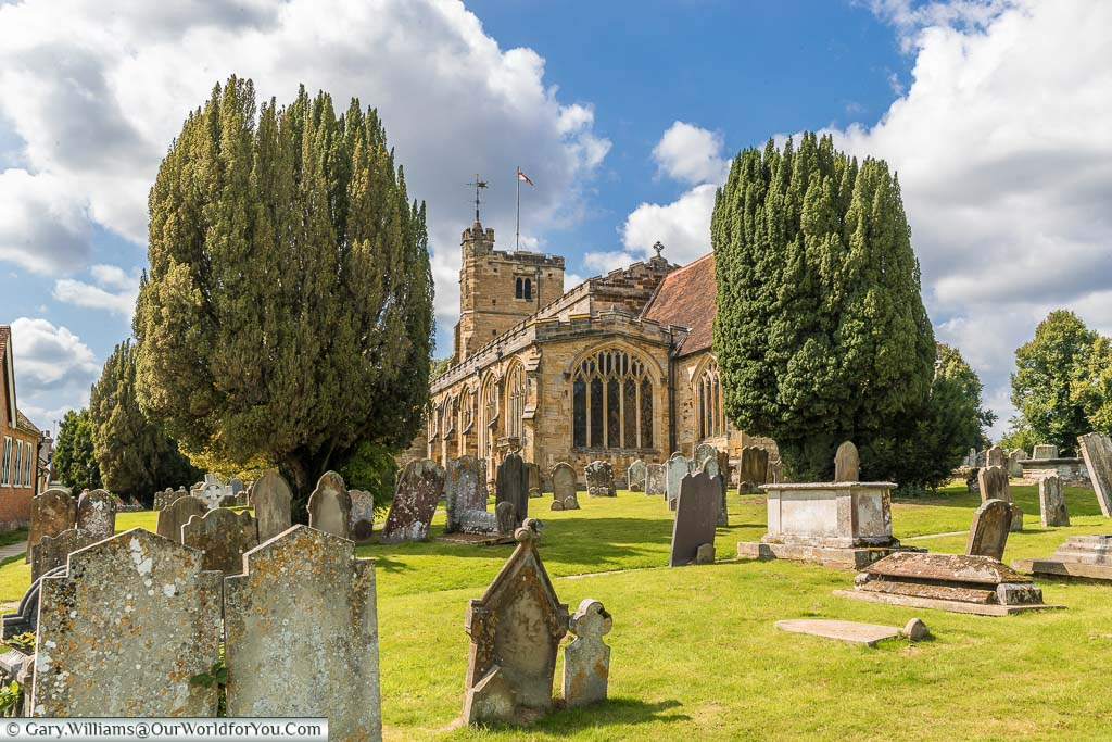 A view over the graveyard towards the apex end the Saint Dunstan's church in Cranbrook on a beautiful sunny day