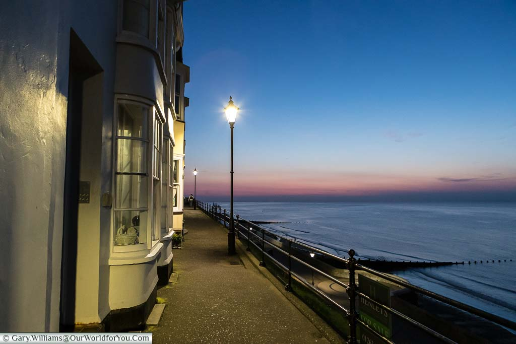The view along the Esplanade at Cromer with the beautiful glow of dusk over the North Norfolk coastline