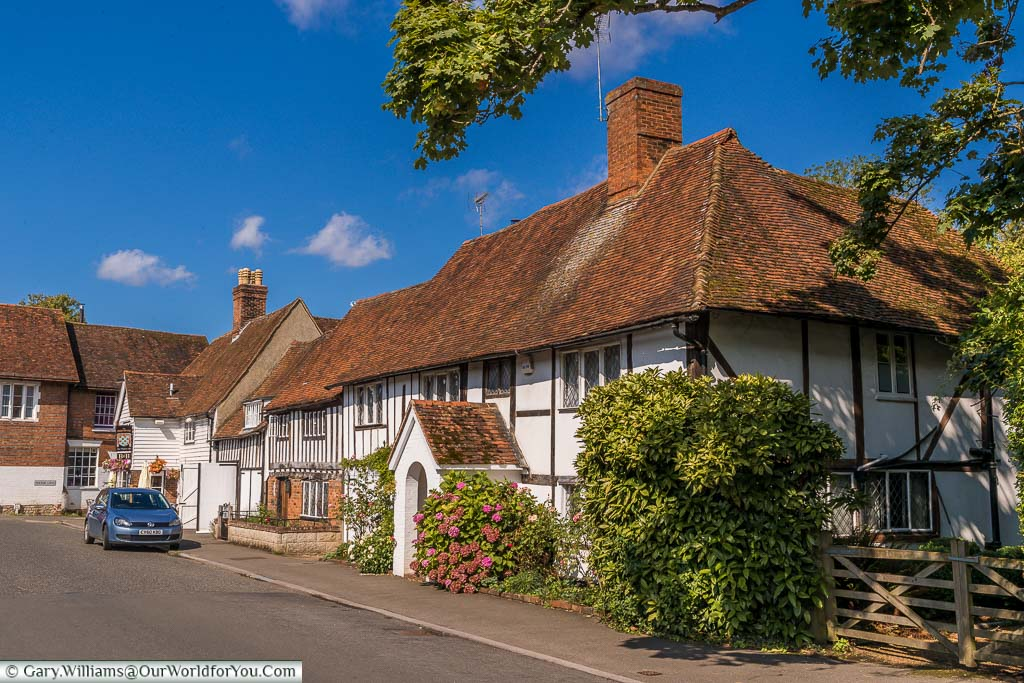 A beautiful black and white half-timbered period building with a red tiled roof. It is now home to the Chequers Inn on the High Street in Smarden Kent