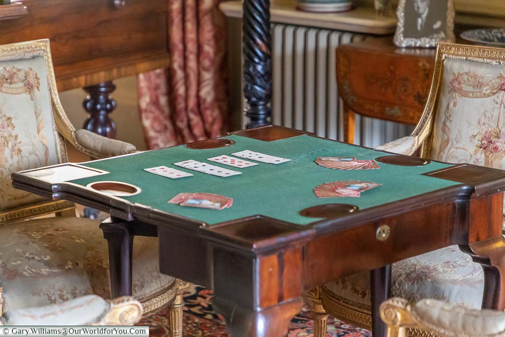 A close up of a card table in the Drawing Room of Ightham Mote