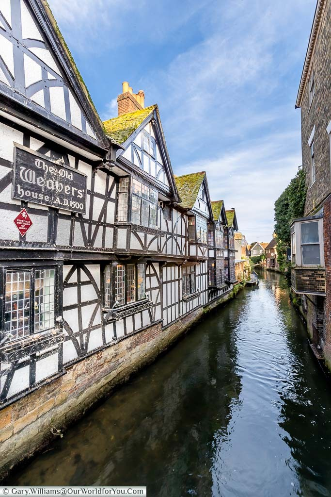 A side shot of the Old Weavers' house alongside a branch of the River Stour running through Canterbury